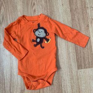5/$20 Orange onsie with monkey